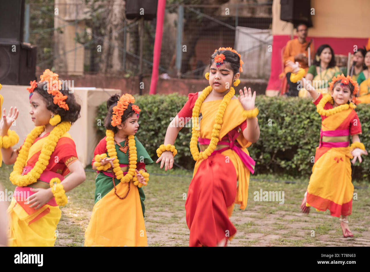 Group,girl,child,dancers,performing, Spring dance,Vasant utsab,,one,little dancing,girl,trying,coping,with,other,girl,dancers,dressedi,in,red,green,ye - Stock Image