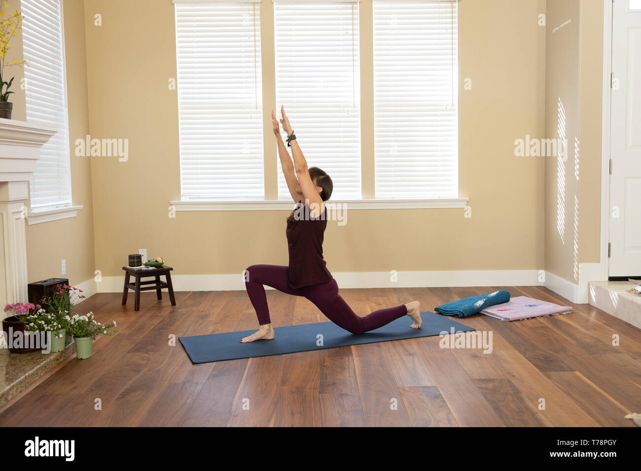 Yoga Low Lunge arms high - Stock Image