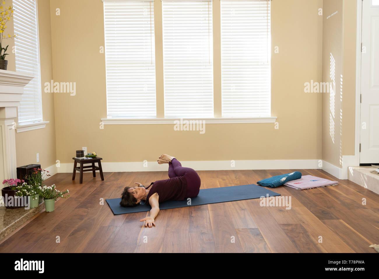 Yoga Supine Twist deep left - Stock Image