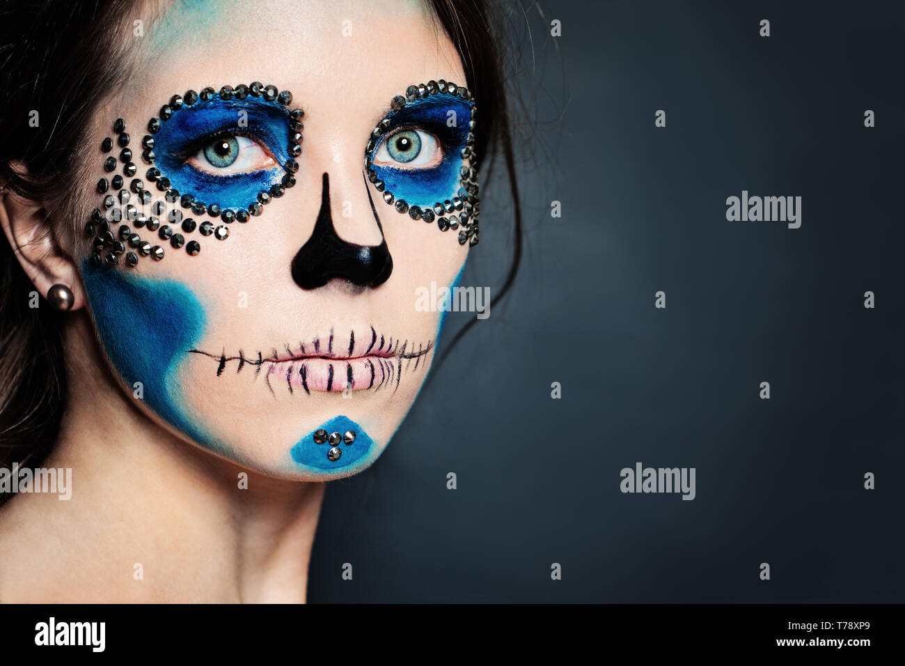 Halloween Character Make Up Woman With Skull Makeup On Blue Background Stock Photo Alamy