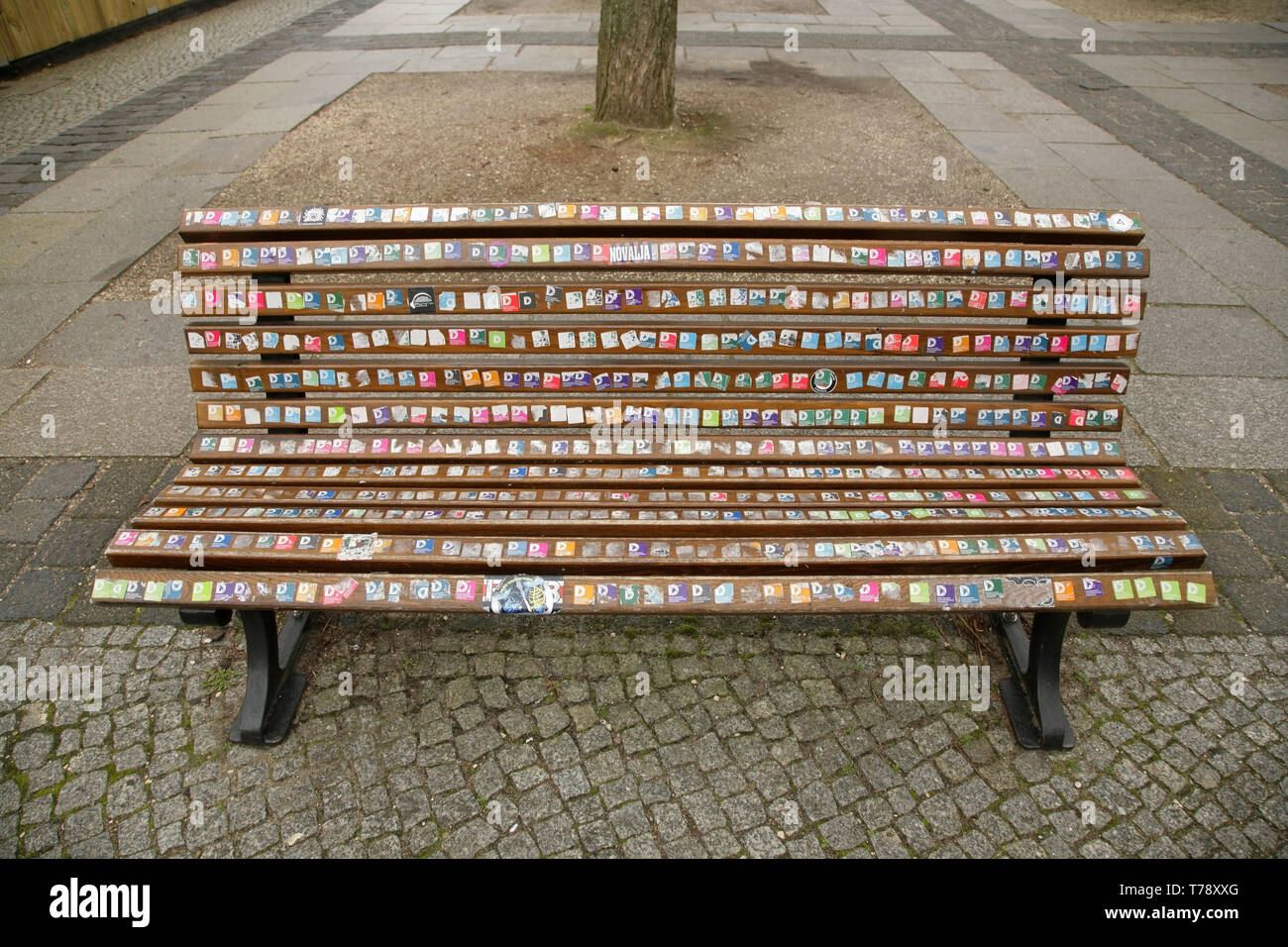 Awesome Wooden Bench Covered With Lots Of Multi Coloured Stickers Lamtechconsult Wood Chair Design Ideas Lamtechconsultcom