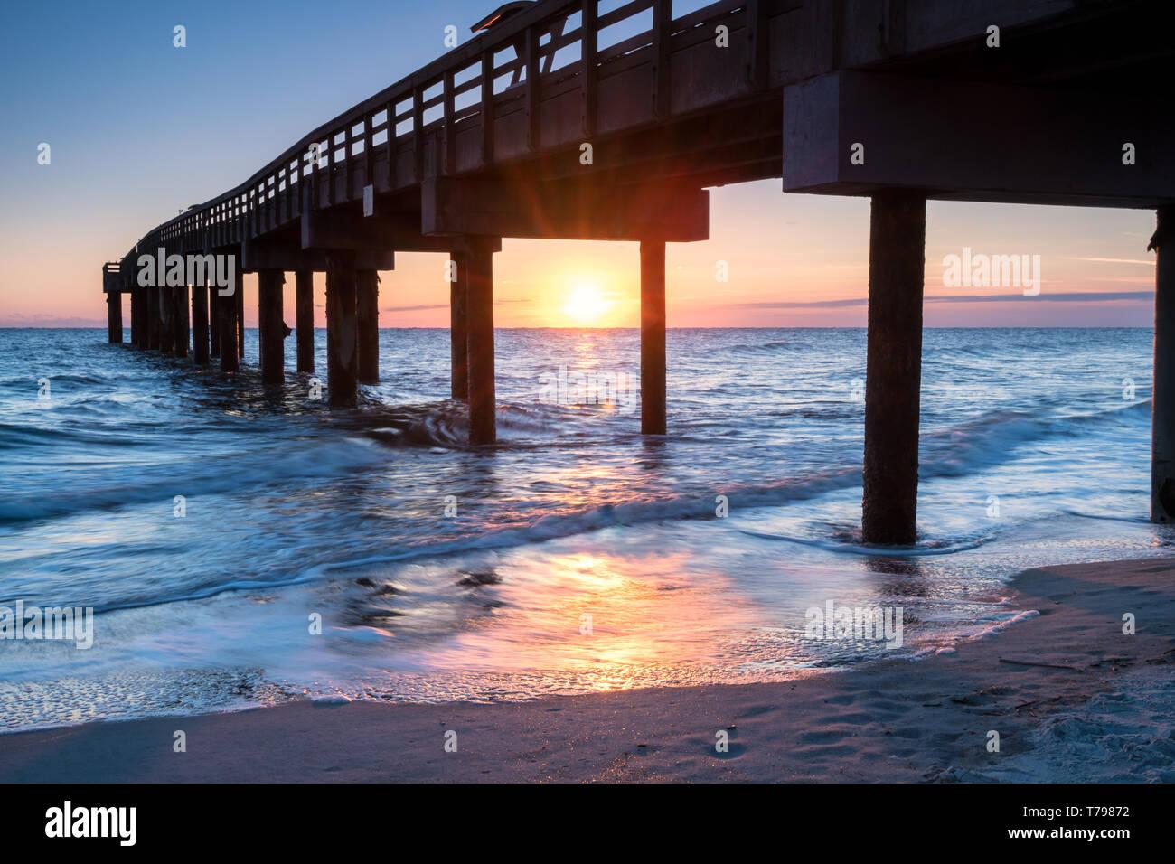 Sunrise at St. Augustine Beach Pier, Florida - Stock Image