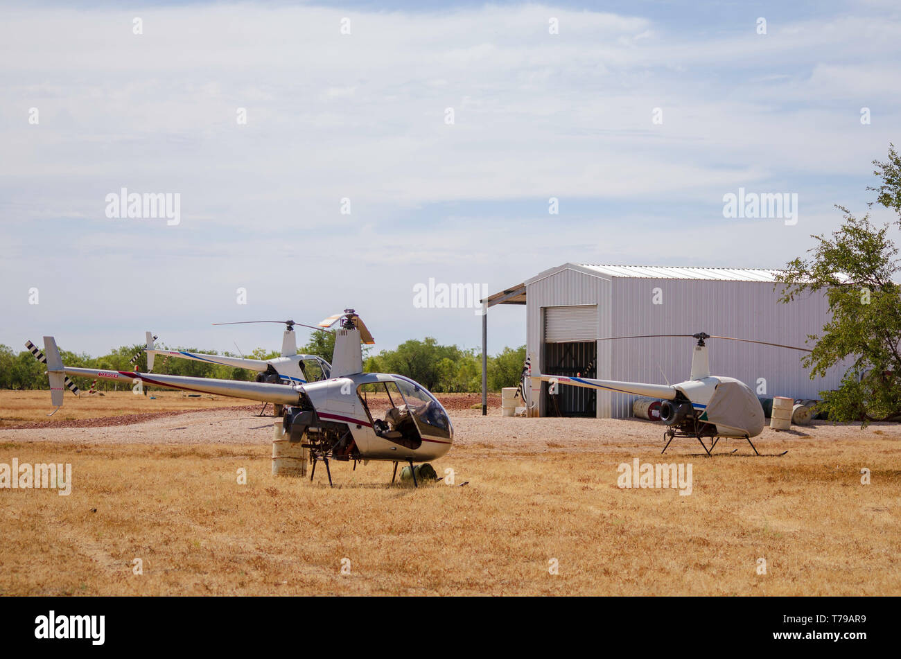 Helicopters ready for the muster on a cattle station - Stock Image