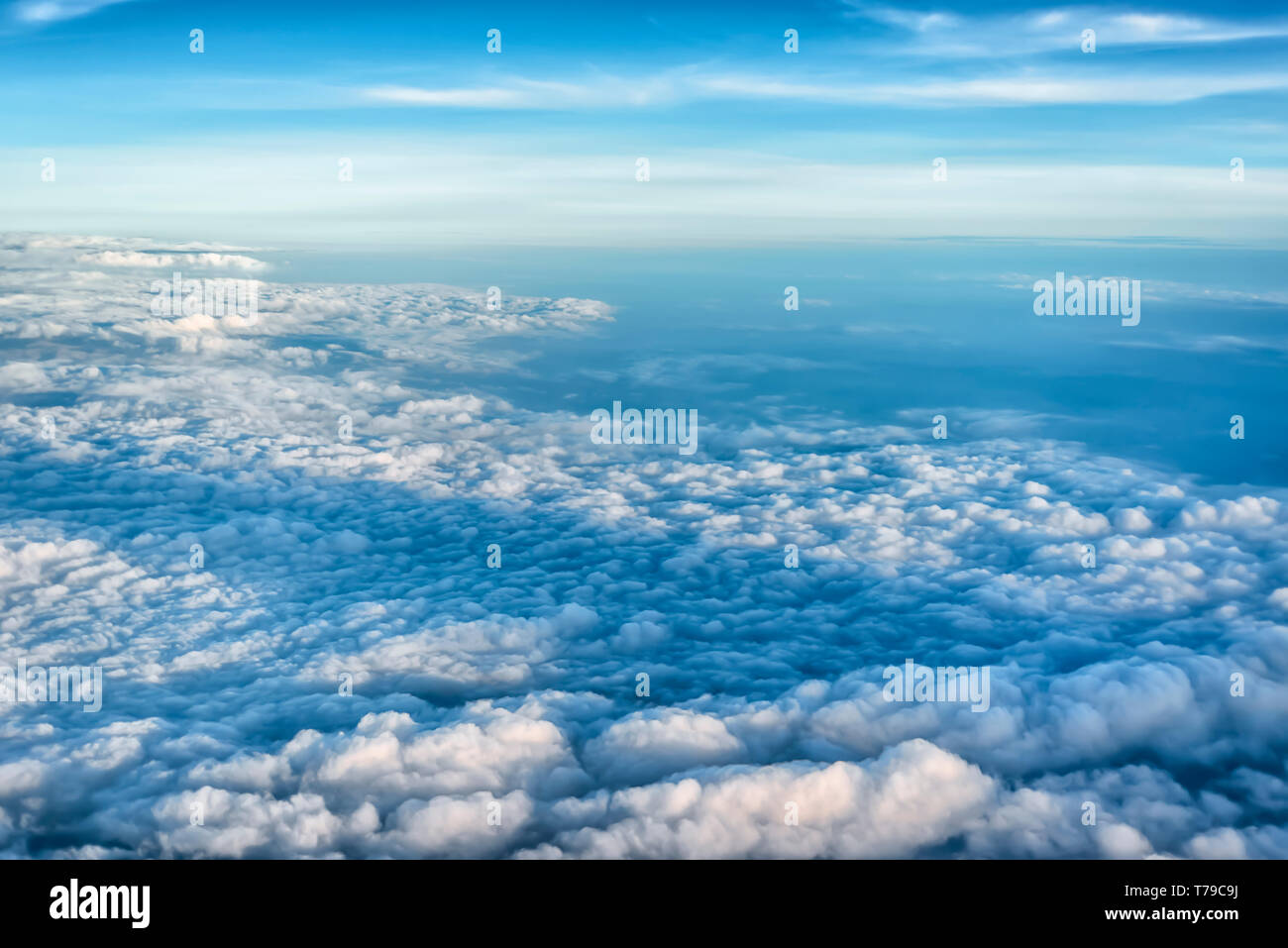 Aerial view of monsoon clouds spread over the wide expanse of plains of India. Cumulonimbus and Cumulus clouds are visible in the frame. - Stock Image