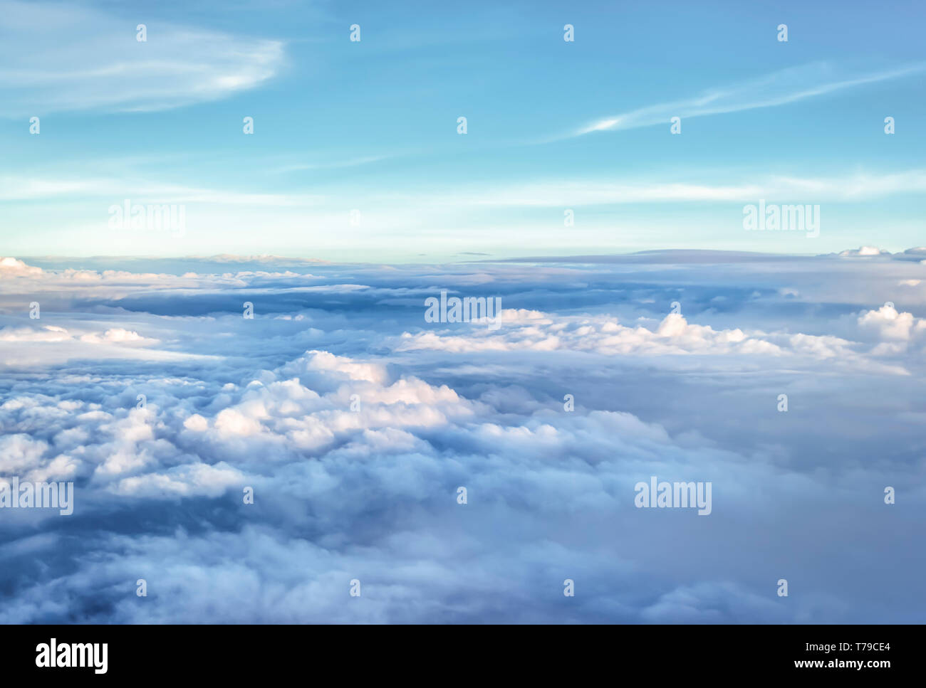 Aerial view of monsoon clouds over plains of India. Taken from a plane that was still climbing after taking off from IGI airport, New Delhi, India. - Stock Image
