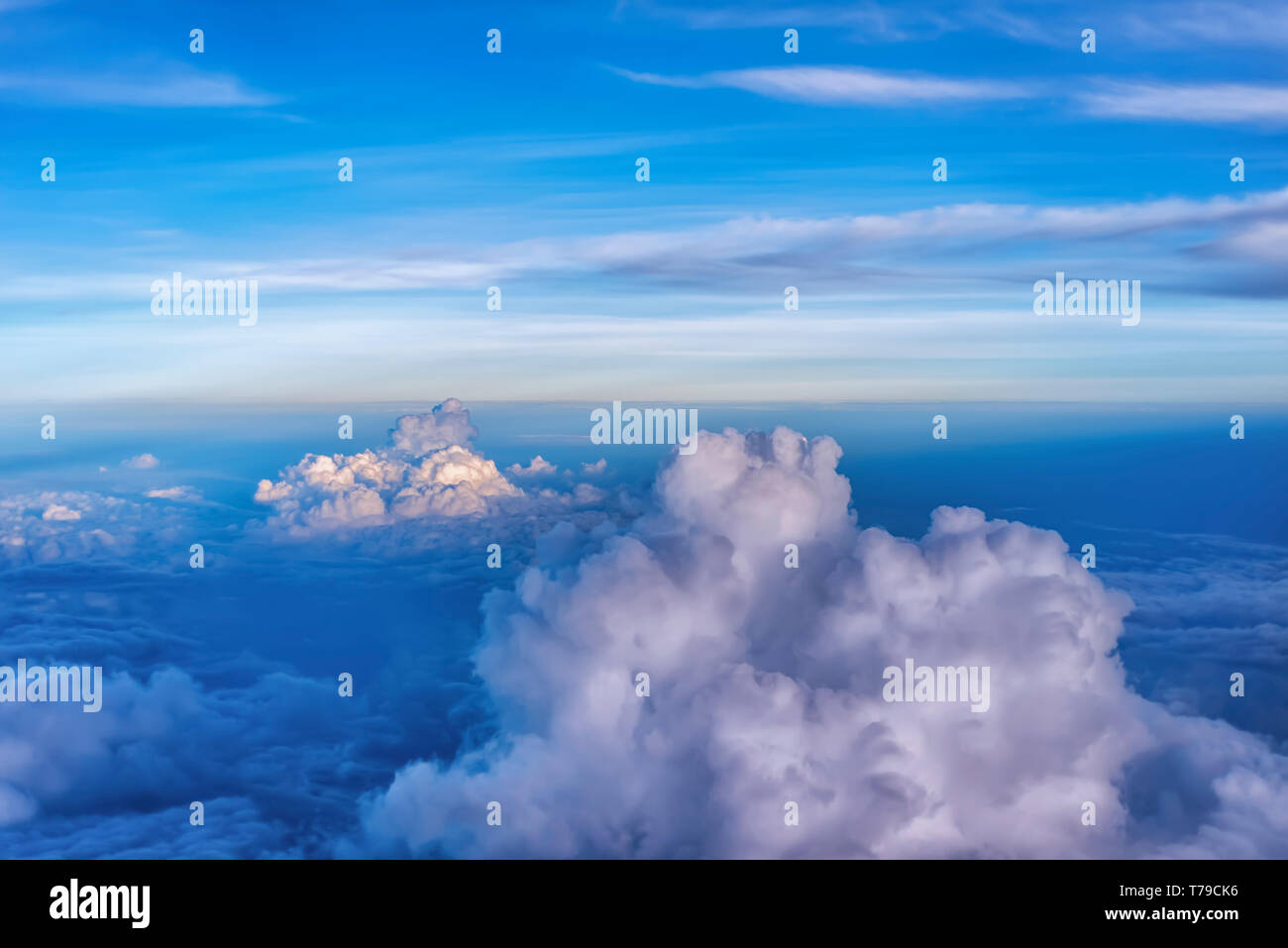 Aerial view of billowy monsoon/storm clouds hanging over the plains of India. Rain bearing clouds--Cumulonimbus and Cumulus are visible. - Stock Image