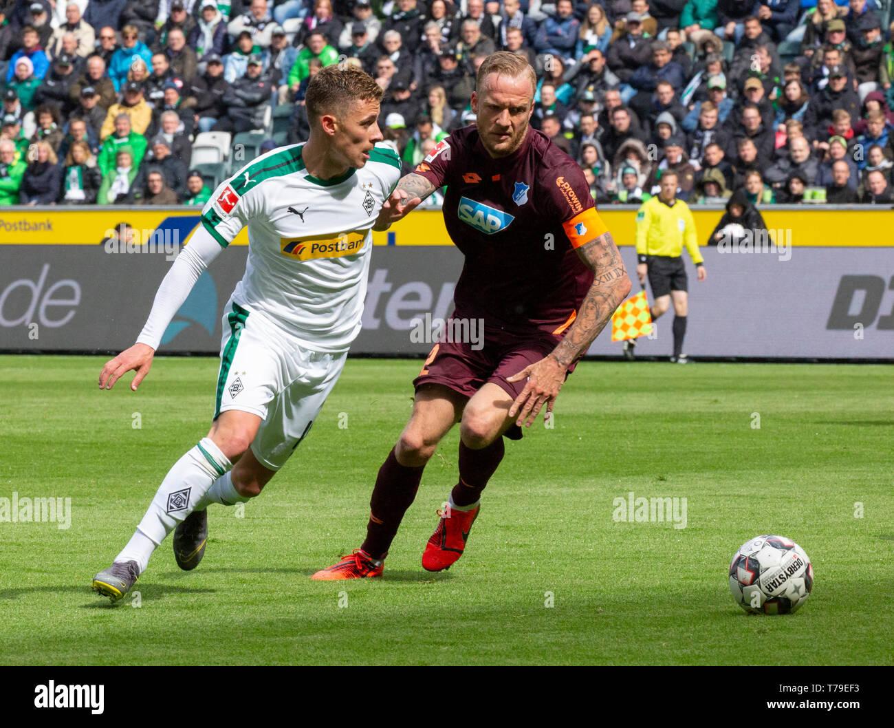 sports, football, Bundesliga, 2018/2019, Borussia Moenchengladbach vs. TSG 1899 Hoffenheim 2-2, Stadium Borussia Park, scene of the match, Thorgan Hazard (MG) left and team captain Kevin Vogt (TSG), DFL REGULATIONS PROHIBIT ANY USE OF PHOTOGRAPHS AS IMAGE SEQUENCES AND/OR QUASI-VIDEO - Stock Image