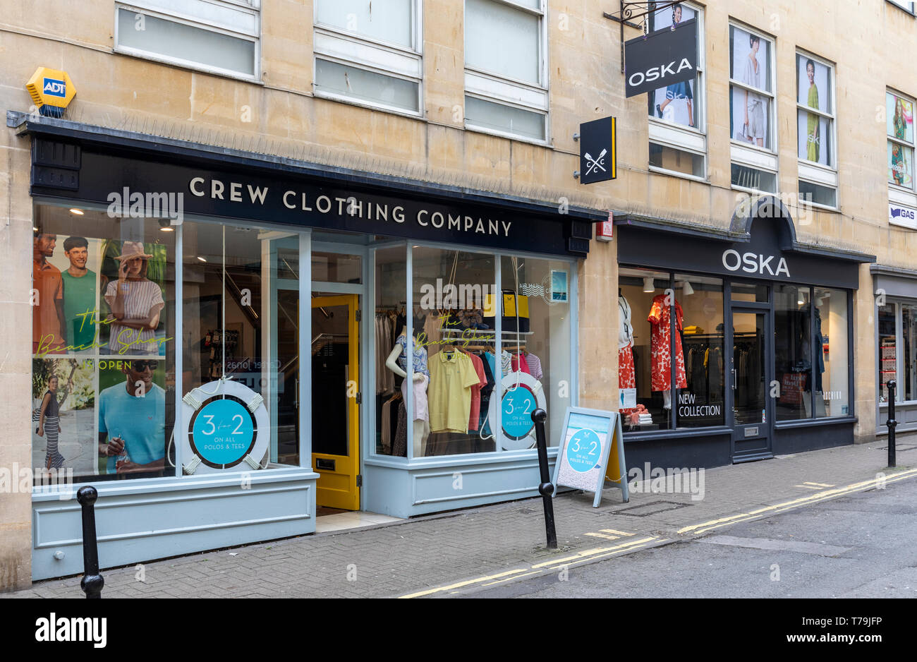 Crew Clothing Company and Oska stores in Upper Borough Walls, Bath, UK - Stock Image
