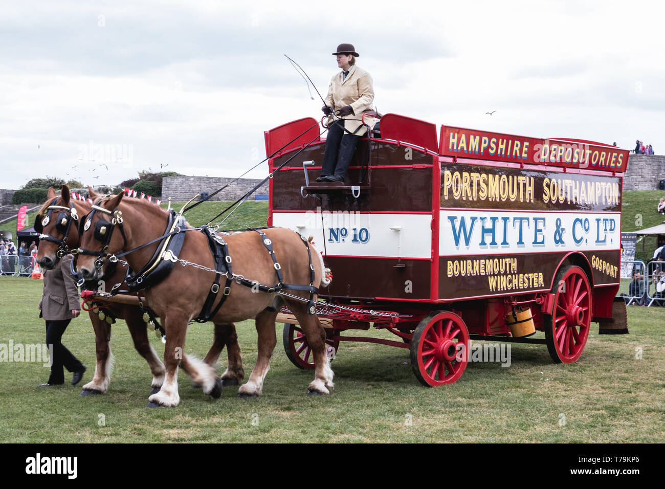 Carriage or trailer being pulled by heavy horses at a horse show in the UK - Stock Image