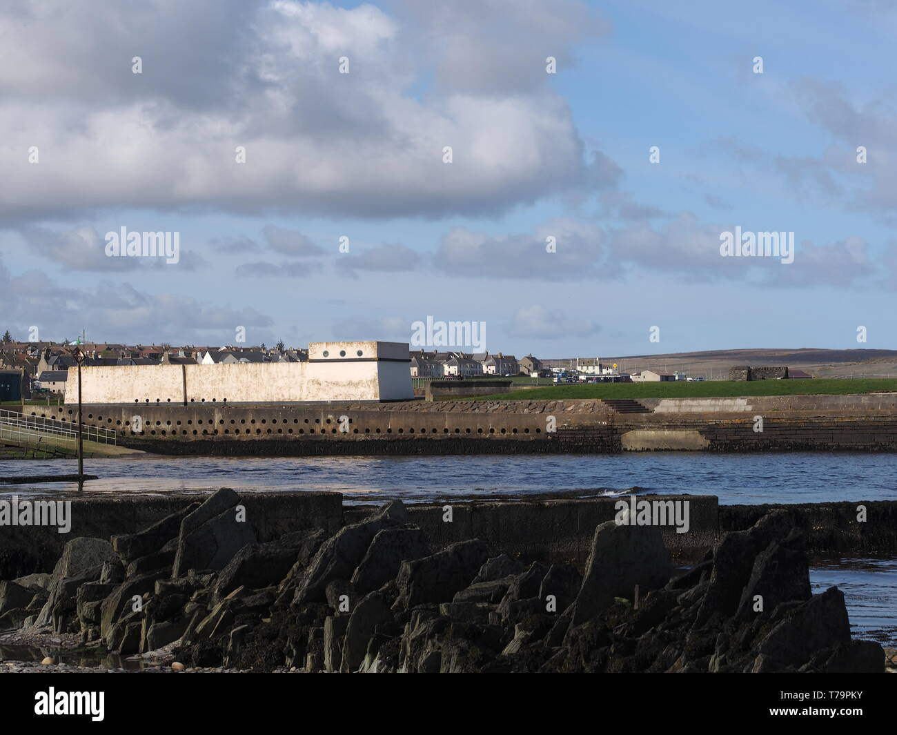 Waste Water Treatment Works Building Near Thurso Harbour with Thurso houses in the background and shoreline opposite Thurso castle. - Stock Image