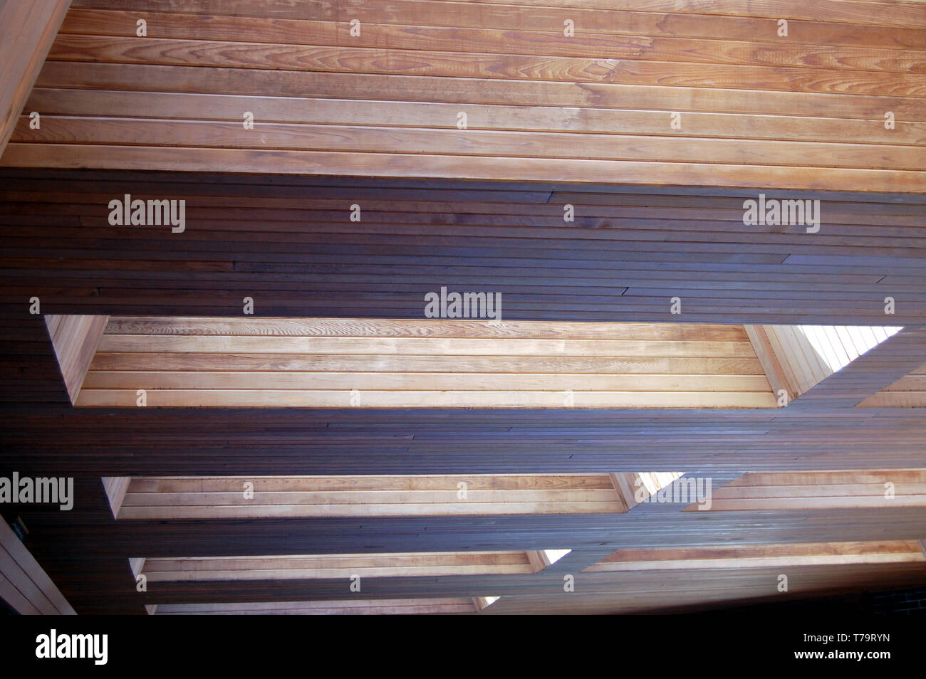 Wooden ceiling with sky-lights Stock Photo