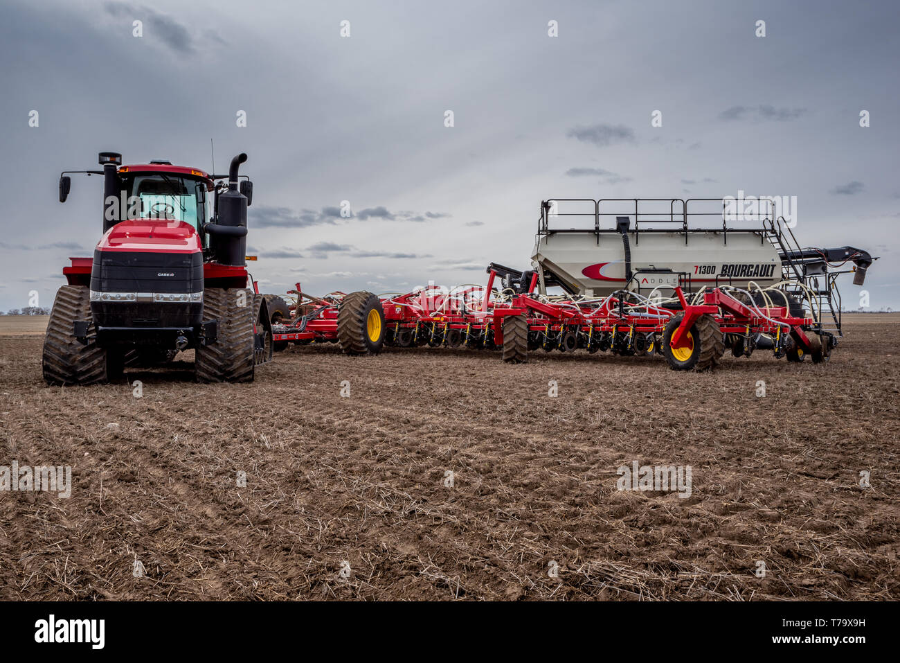 Swift Current, SK/Canada- May 4, 2019: Tractor and air drill seeding equipment in the field in Saskatchewan, Canada - Stock Image