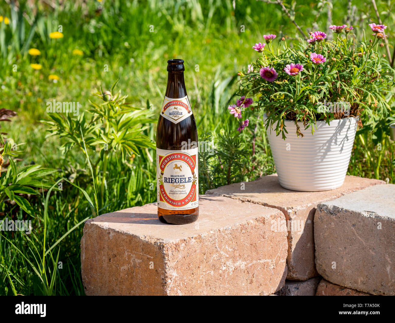 Augsburg Germany May 3 2019 A Bottle Of Riegele Beer On A Stone Wall With Flowers And Gras In The Background Stock Photo Alamy
