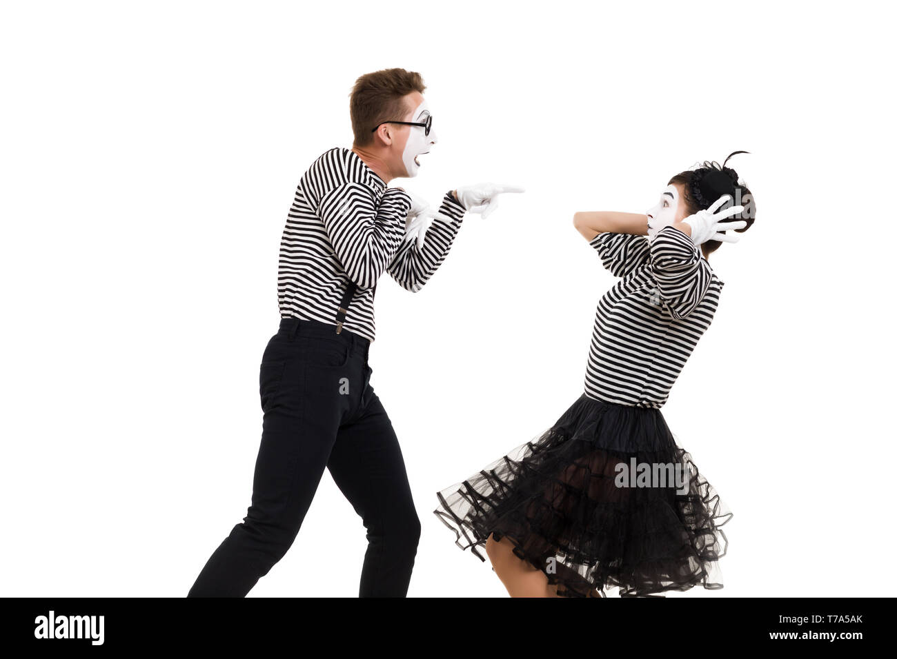 mime couple quarrels and shouts at each other isolated on white background - Stock Image