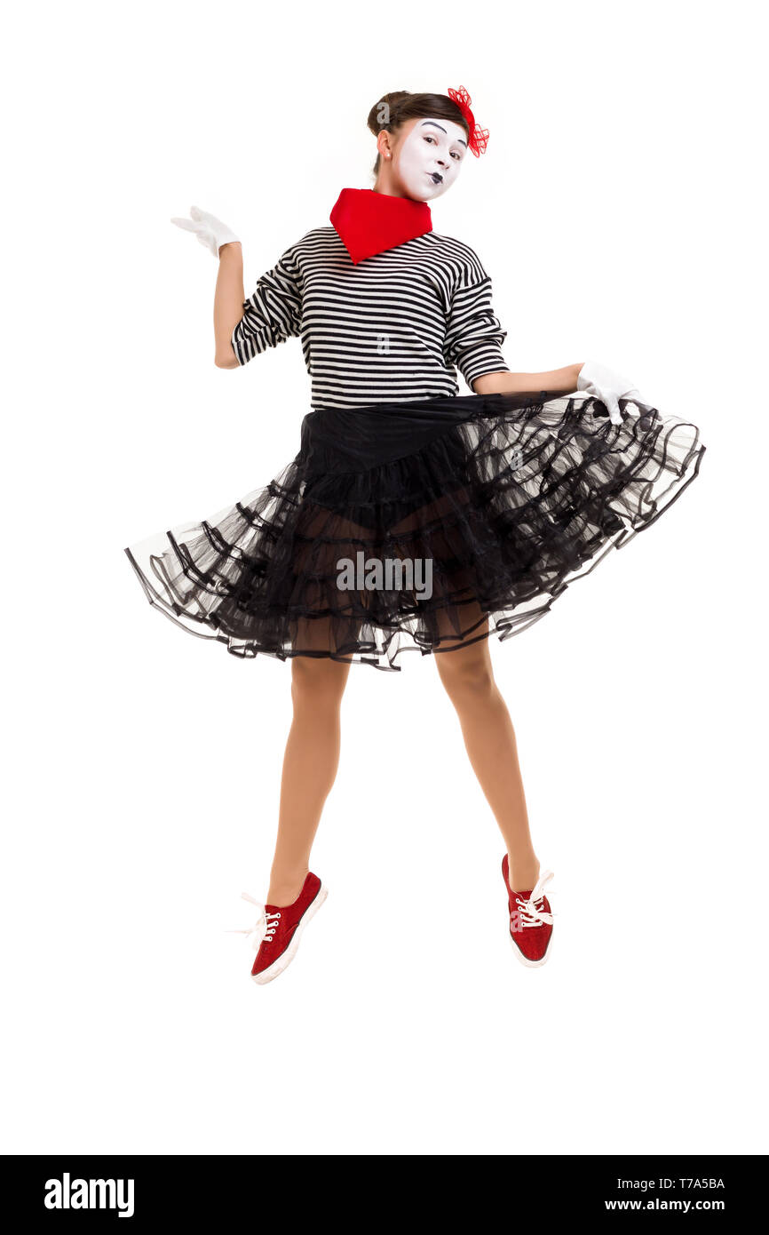 Full length portrait of mime woman artist jumping isolated on white background - Stock Image