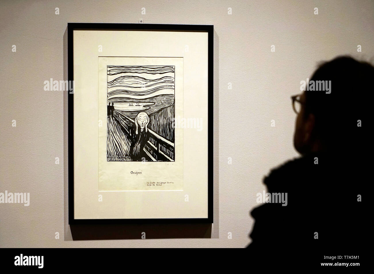 A visitor in front of the Scream (1895) by Edvard Munch.Lithographic crayon in collection of the Metropolitan Museum of Art.New York City.USA - Stock Image