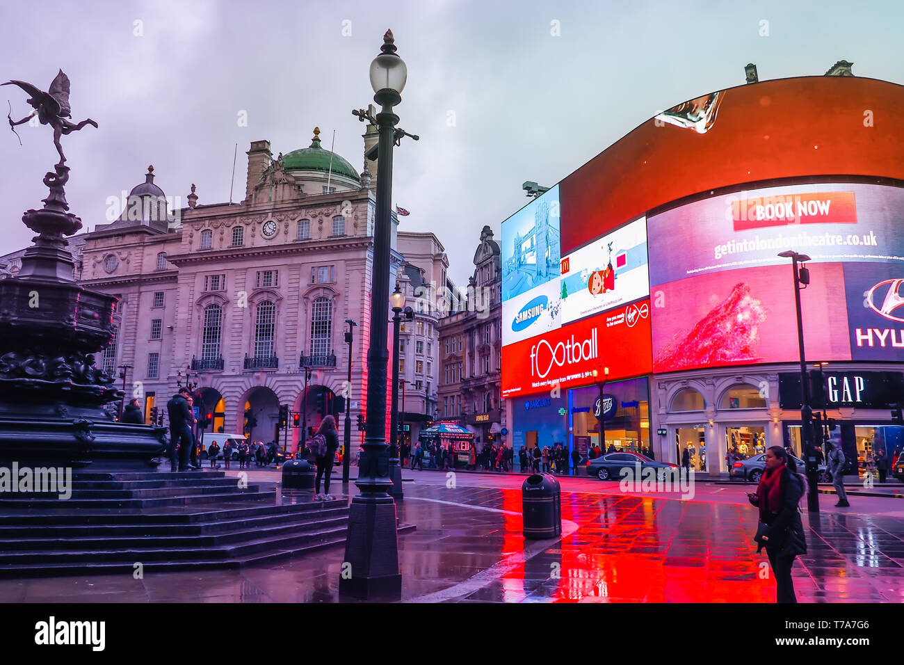 Piccadilly Circus with the Shaftesbury Memorial Fountain and advertising screens, a famous London landmark and busy destination for tourists. - Stock Image