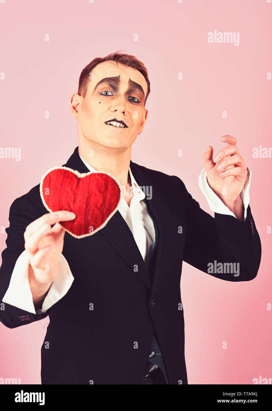 Playing love. Mime man hold red heart for valentines day. Love confession on valentines day. Mime actor with love symbol. Theatre actor pantomime - Stock Image