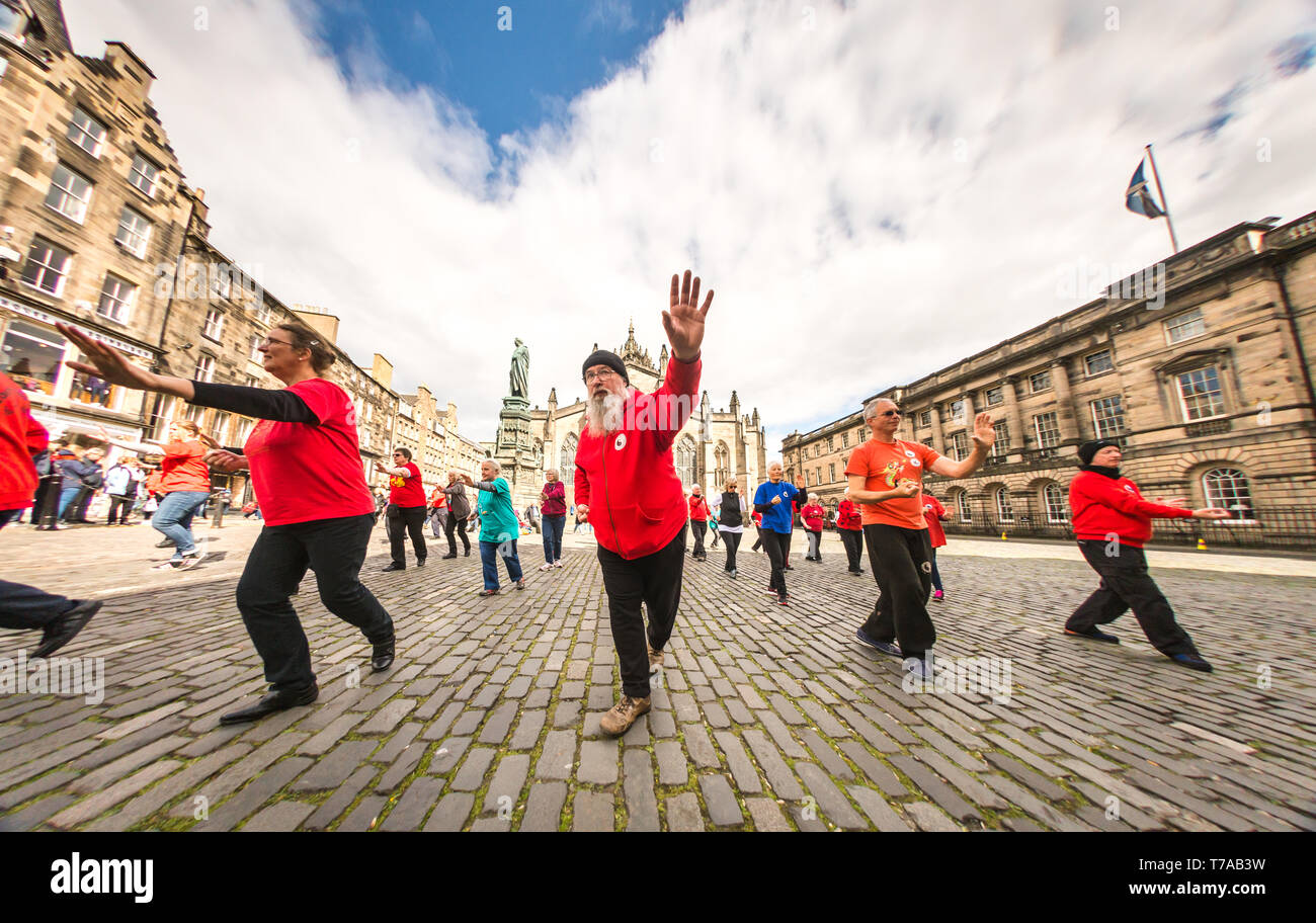 Sun 5 May 2019. Edinburgh, UK. A Tai Chi class takes place in the historic Parliament Square as part of the city's first Open Streets event. - Stock Image