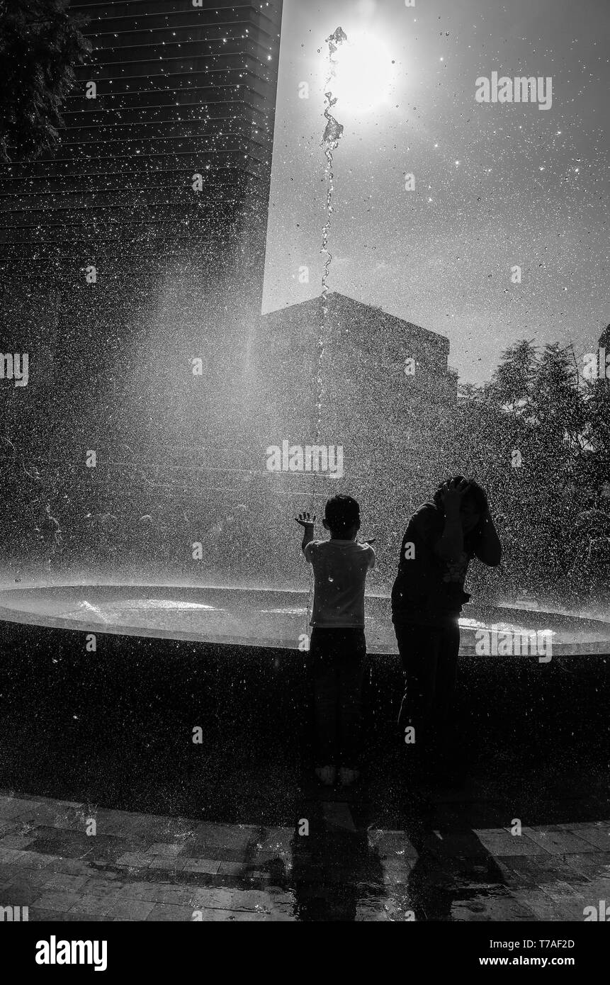 Children playing with water in a Fountain at the Alameda Central Park. Mexico City. - Stock Image