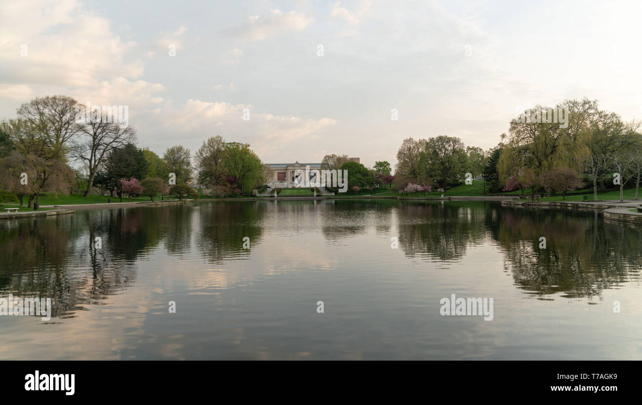 Cleveland, Ohio/USA - May 1, 2019: The Cleveland Museum of Art in the distance with closeup view of The Wade Park Lagoon. Stock Photo