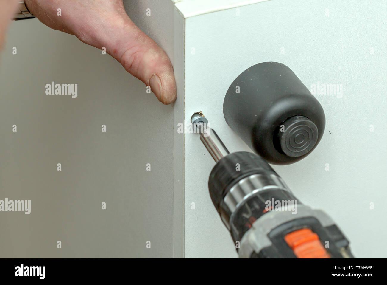 The process of furniture assembly screws closeup - Stock Image