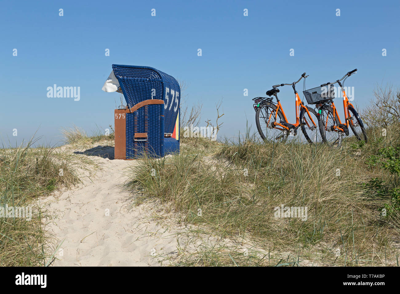 beach chair and bicycles in the dunes, Hooksiel, Wangerland, Lower Saxony, Germany - Stock Image