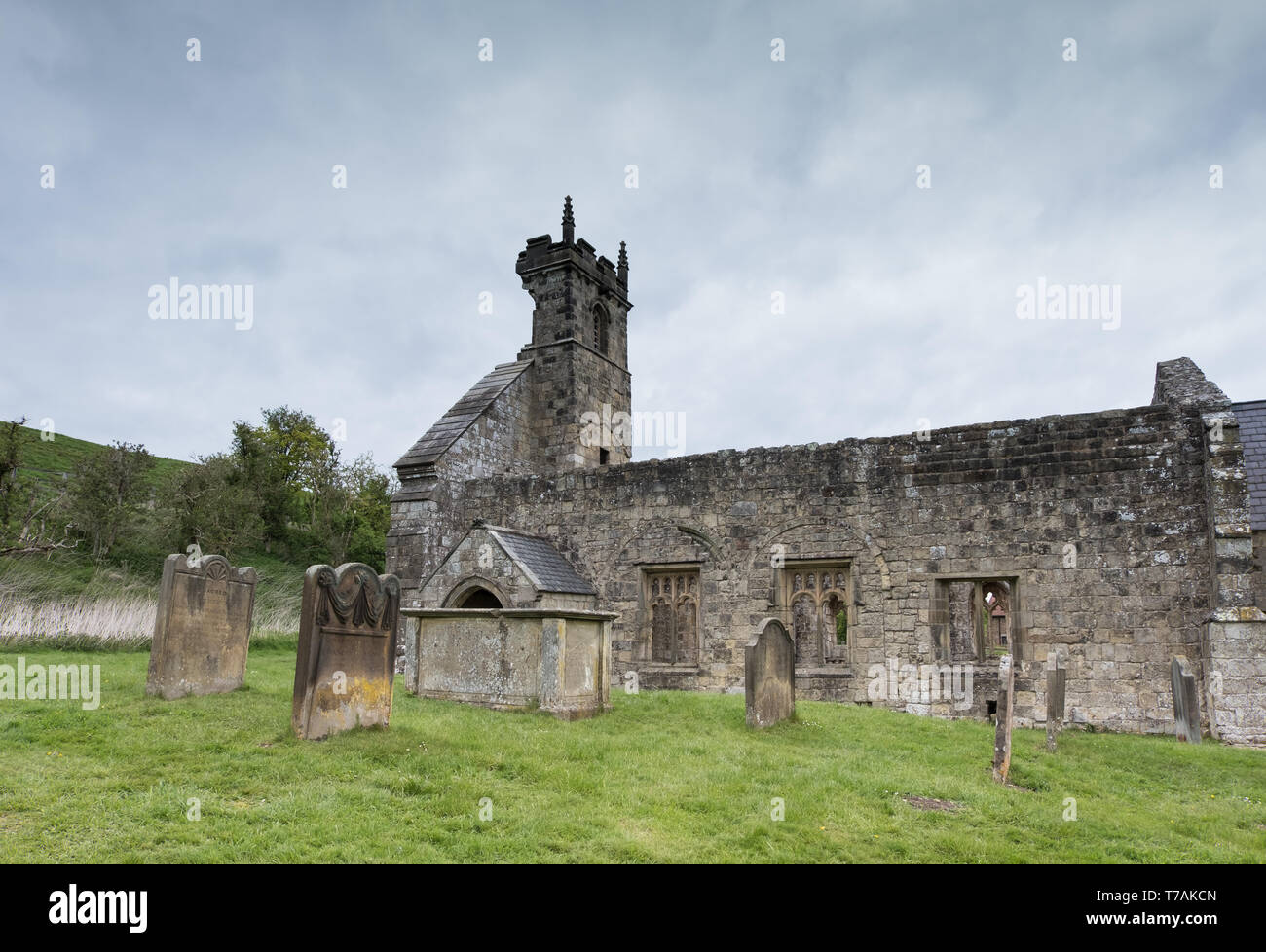 St Martins church in the deserted medieval village of Wharram Percy in North Yorkshire - Stock Image