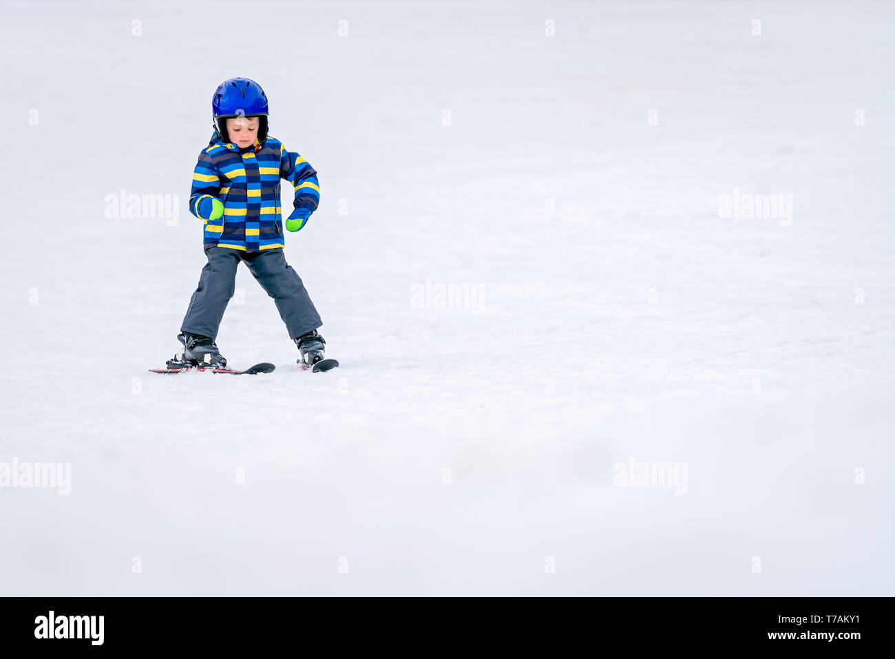 Little boy skiing unassisted for the first time - Stock Image