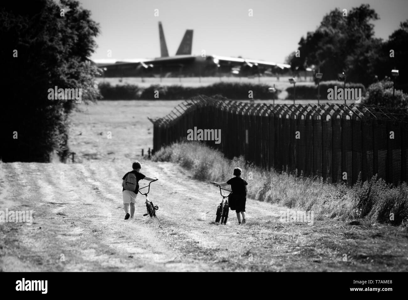 Two children going out to see the bombers after school - Stock Image