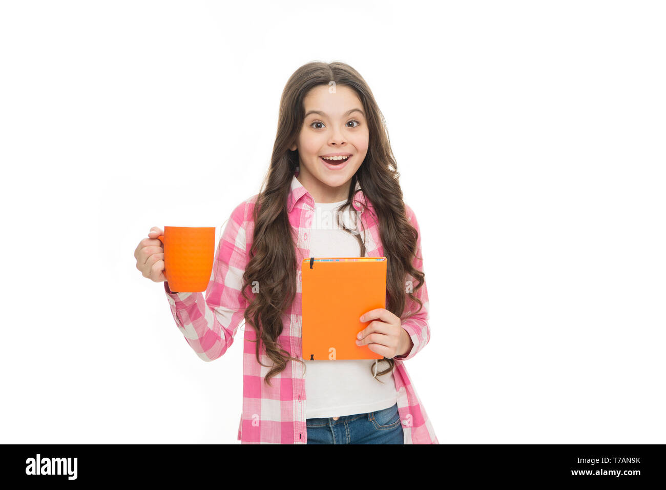 happy child hold note book and tea cup. ready for reading. little business lady. back to school. surprised school gorl drink tea. time for rest. Spend nice time with favorite book. reading book lover. - Stock Image