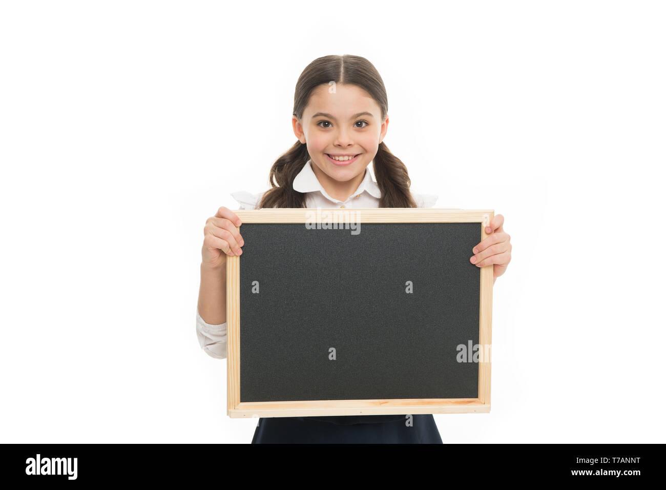 Perfect schoolgirl. Happy girl wear school uniform. Back to school concept. Schoolgirl smiling pupil long hair. Diligent schoolgirl hold blank chalkboard copy space. Announcement and advertisement. - Stock Image