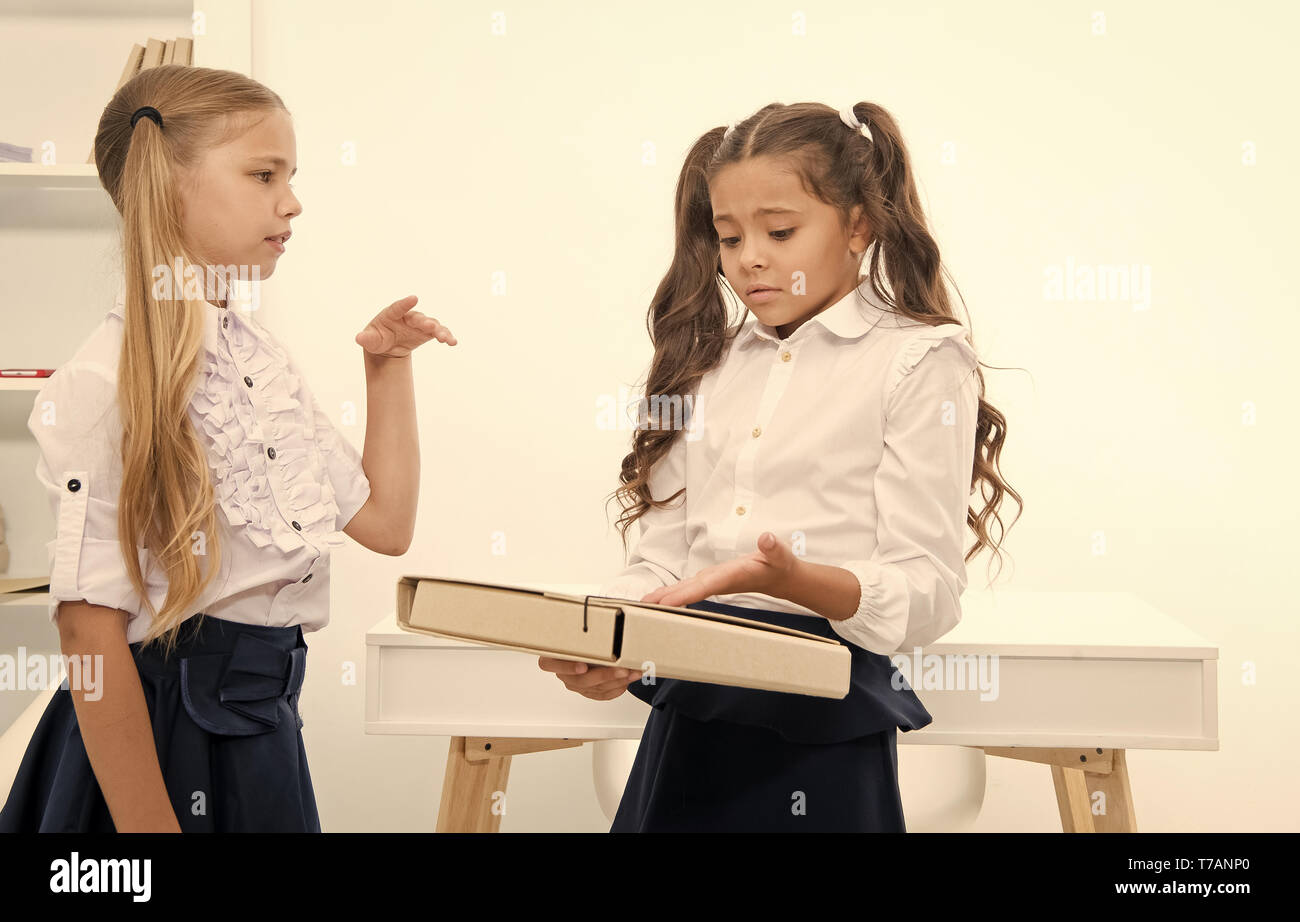 Little girls discuss problem on school day. little girls work on problem solution in classroom. - Stock Image