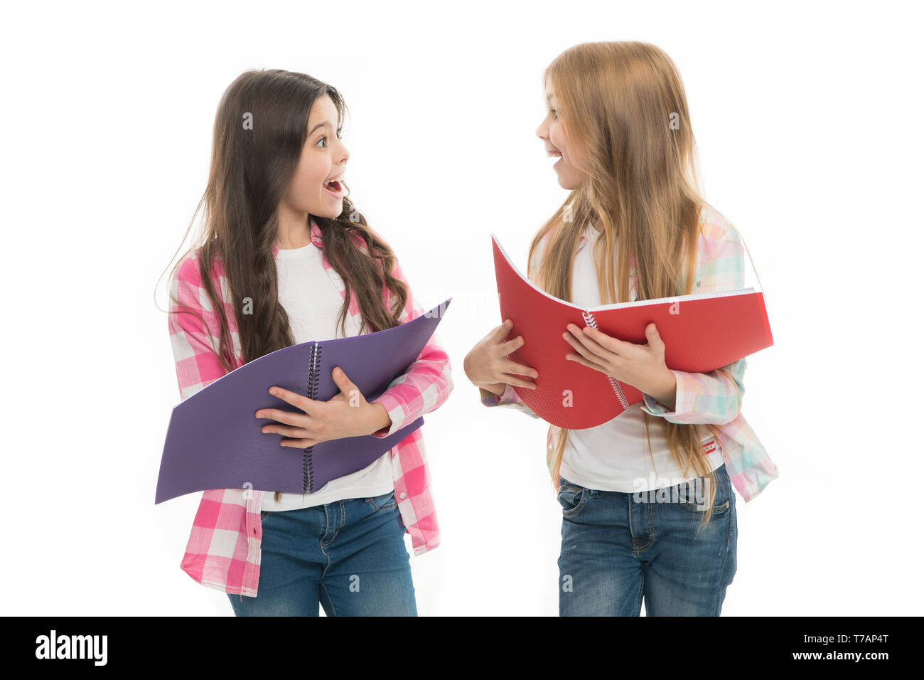 Worry about passing exam. Check knowledge. Final exam coming. Girls hold textbooks white background. School exam concept. Prepare for exam. School stationery. Pupils carrying textbooks to classes. - Stock Image