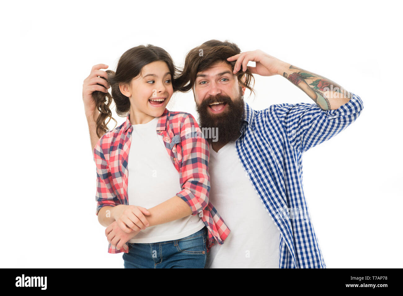 Spending nice time at home. Going crazy together. happy little girl with father. little child love her dad. fathers day. childrens day. family bond. having fun together. father and daughter. haircare. - Stock Image