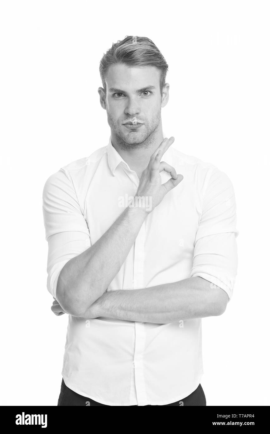 Excellent quality. Man confidently highly recommend white background. Guy with bristle recommend excellent item. Man shop consultant looks confident and hospitable. Guy shows excellent gesture. - Stock Image