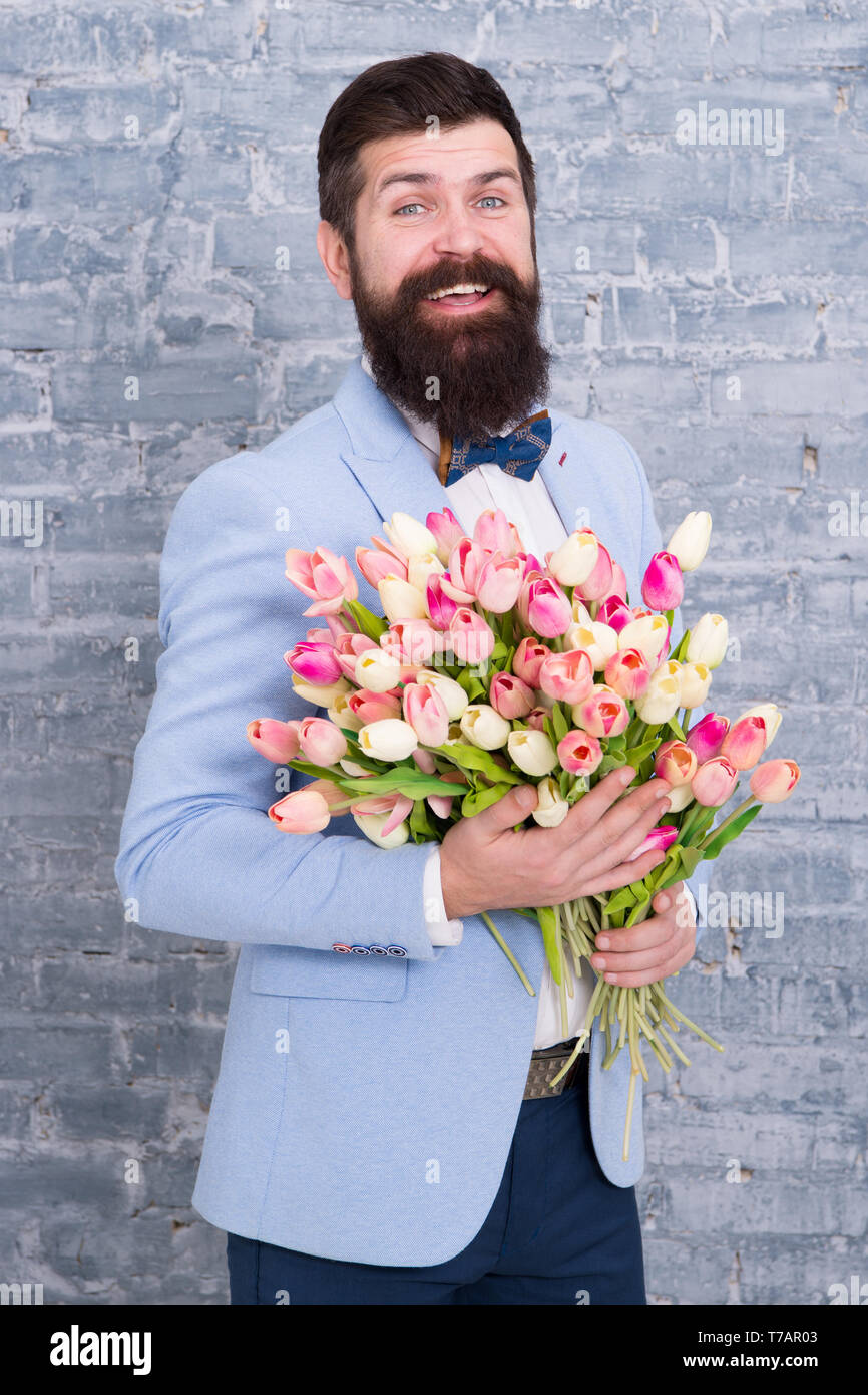 Womens day. Love bouquet. international holiday. Bearded man with tulip bouquet. Flower for March 8. Spring gift bouquet. Bearded man hipster with flowers. Spring in my head. Spring bouquet. - Stock Image