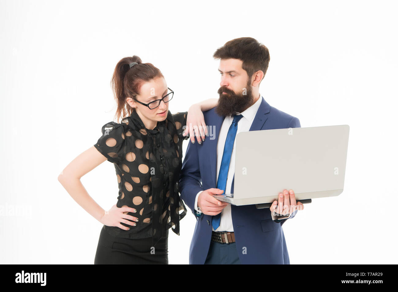 Financial indicators. Couple working using laptop. Business lady check what is done. Lady boss satisfied with business indicators. Manager show result. Report business result. Financial report. - Stock Image