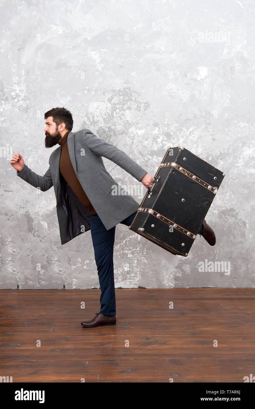 Man in a hurry. Hurry up. Man with big travel bag is in hurry. rush hour. businessman running. Businessman in a hurry. Late again. deadline. another deadline. Working hard to meet deadlines. - Stock Image