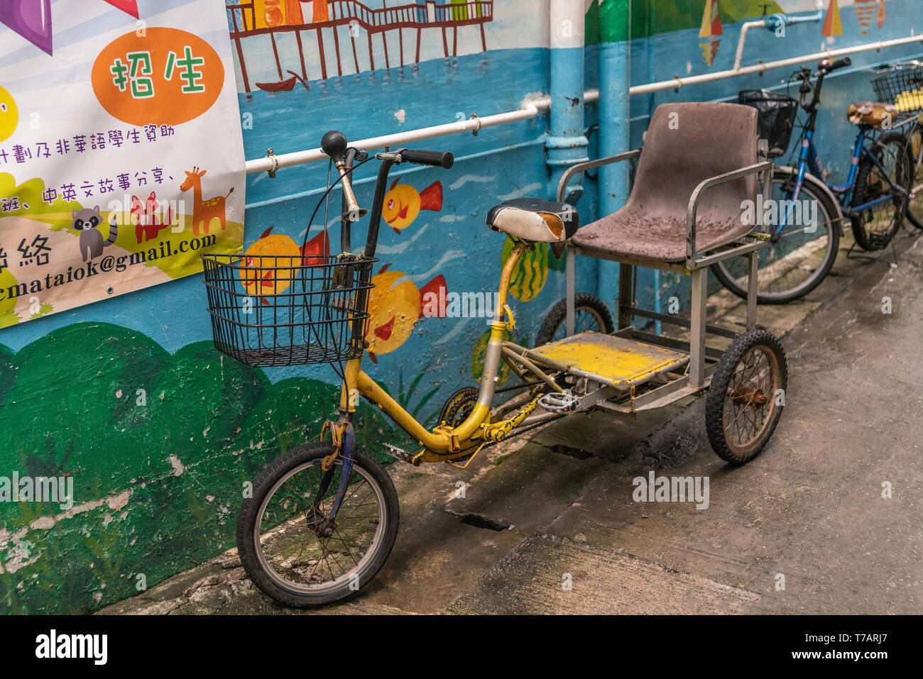 Hong Kong, China - March 7, 2019: Tai O Fishing village. Tricycle one-guest taxi parked in street, for family use to transport elderly disabled family - Stock Image