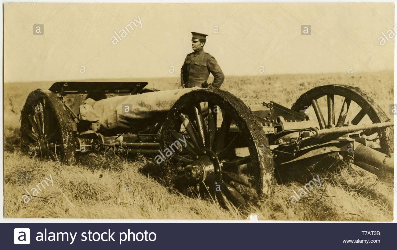 Carl-Michel-Horizontal, sepia photograph showing a uniformed man standing next to an artillery gun on wheels i - Stock Image