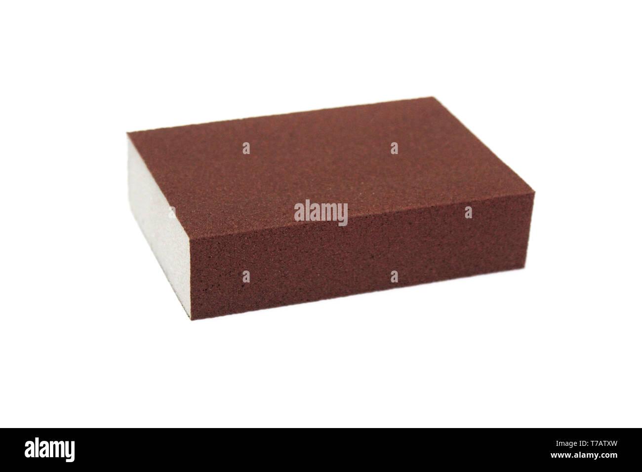 Isolated sanding block sponge over white background - Stock Image