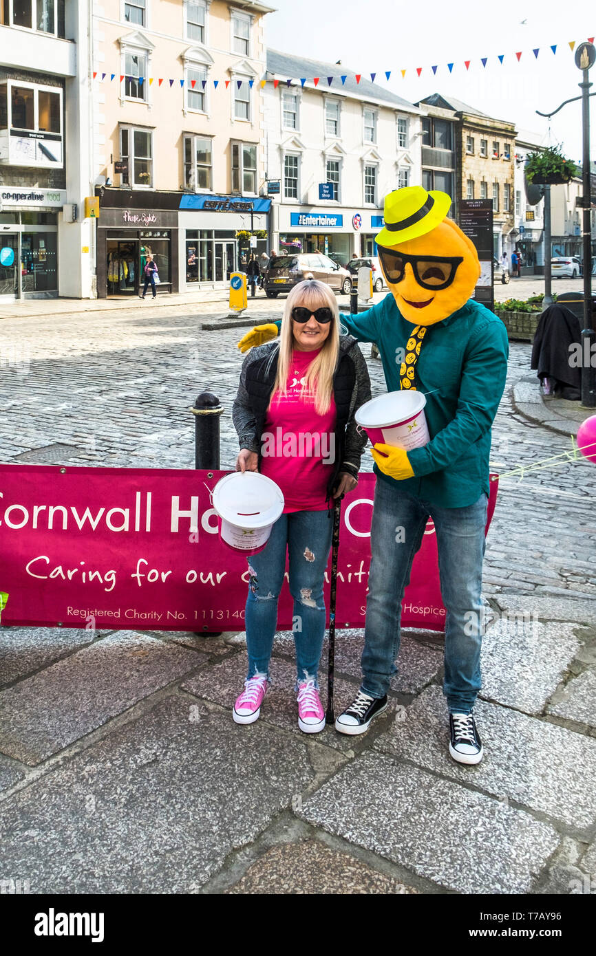 Charity workers fundraising Cornwall Hospice Care in Truro City centre in Cornwall. Stock Photo