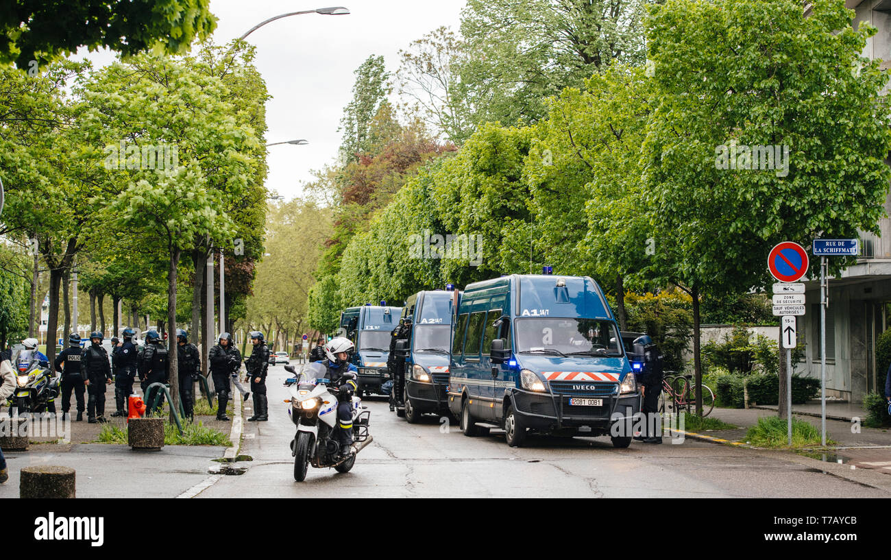 Strasbourg, France - Apr 28, 2019: Squadron of police gendarms officers securing entrance to Council of Europe over Allee de la Robertsau after altercations with Yellow Vests Gilets jaunes   - Stock Image