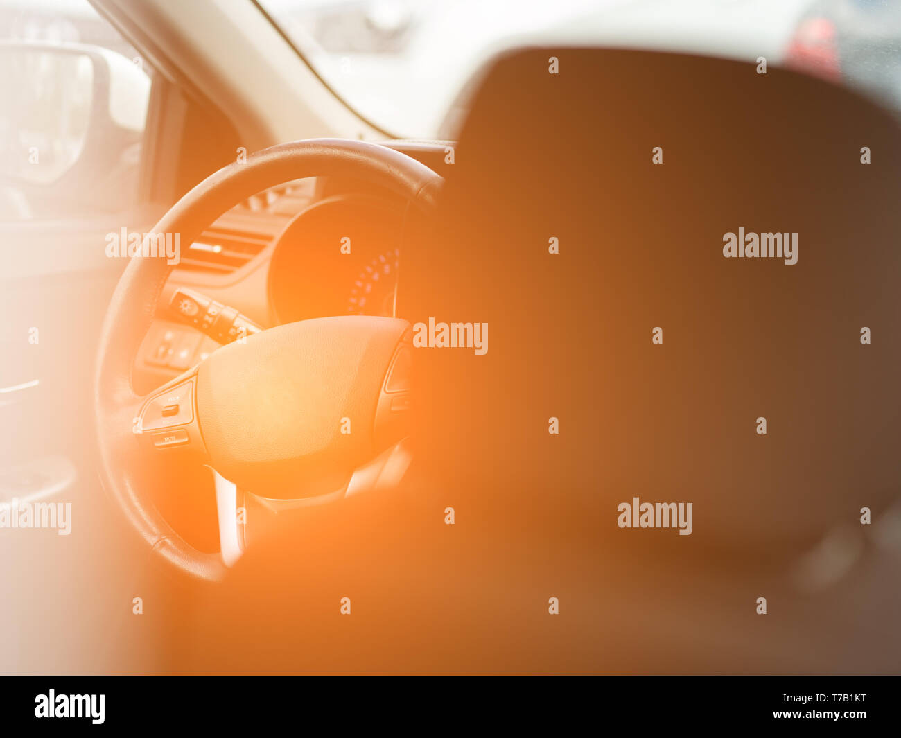 View to the black color interior of car with front seats, steering wheel and dashboard . Auto service industry Stock Photo