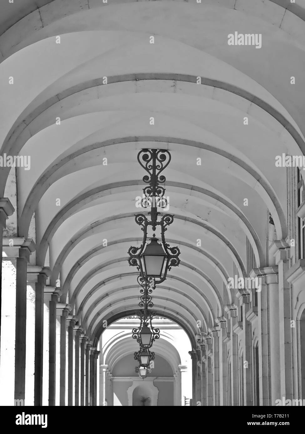 Beautiful arcades with lamps in Arco rua do Augusta in Lisbon - Stock Image