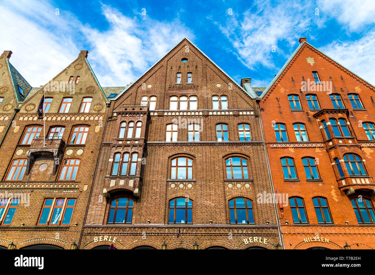 Brick buildings with gables reconstructed to match the historic hanseatic buildings in Bryggen, Bergen, Norway - Stock Image