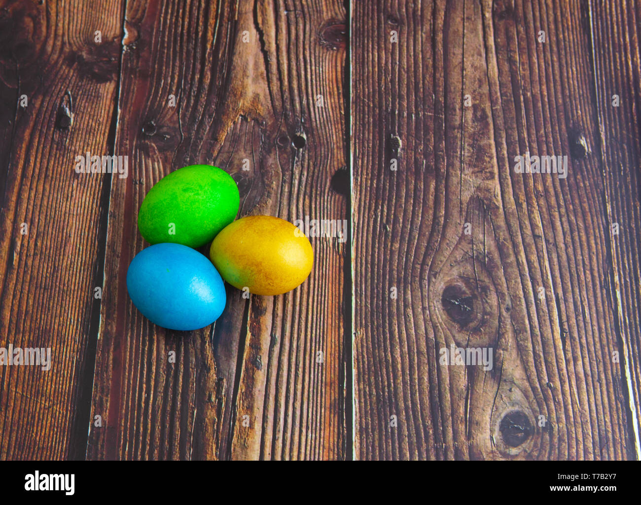 Beautiful colorful Easter eggs. Easter concept on dark wooden background Stock Photo