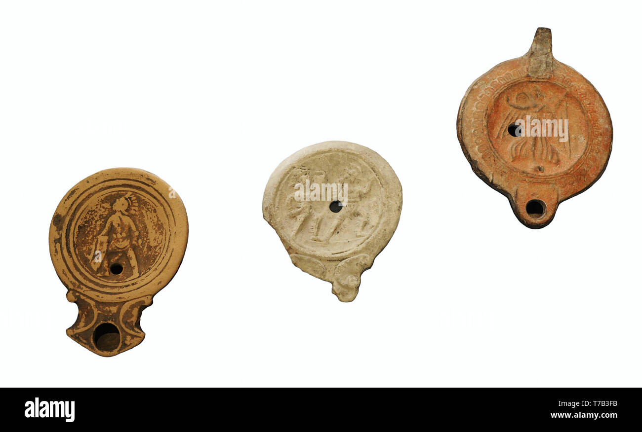 Roman lamps. Clay. 1st century AD. From left to right: Gladiator (Urso, Osuna, Sevilla province, Andalusia), Gladiators (Iponuba, Baena, Cordoba province, Andalusia) and Goddess Victoria (El Djem, Tunisia). National Archaeological Museum. Madrid. Spain. - Stock Image
