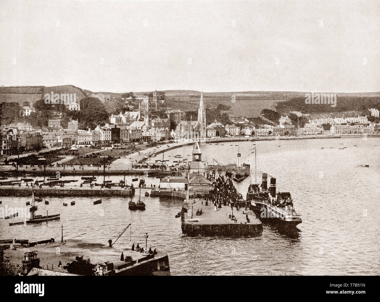 A late 19th Century view of Rothesay, principal town on the Isle of Bute in the Firth of Clyde, Argyll and Bute, Scotland. It developed as a popular tourist destination for Glaswegians going 'doon the watter'.  Rothesay was also the location of one of Scotland's hydropathic establishments during the 19th century boom years of the Hydropathy movement. It also had an electric tramway - the Rothesay and Ettrick Bay Light Railway - which stretched across the island to one of its largest beaches. - Stock Image